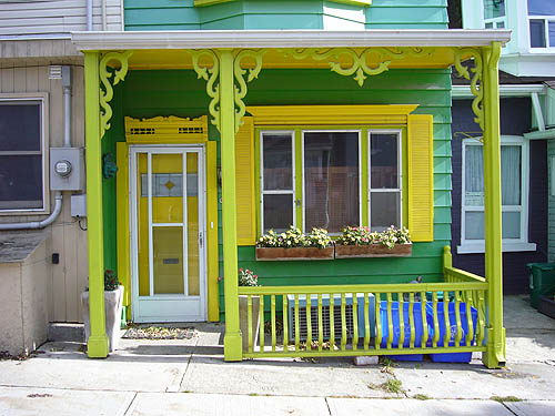 Porch is painted in yellow and green