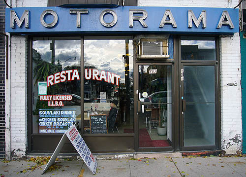Sign over restaurant read MOTORAMA in widely-spaced, illuminated letters