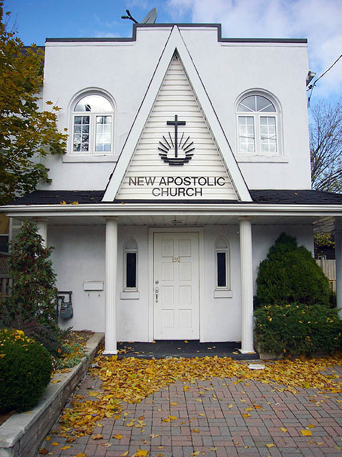 Symmetrical gabled entranceway with Doric columns is labelled NEW APOSTOLIC CHURCH