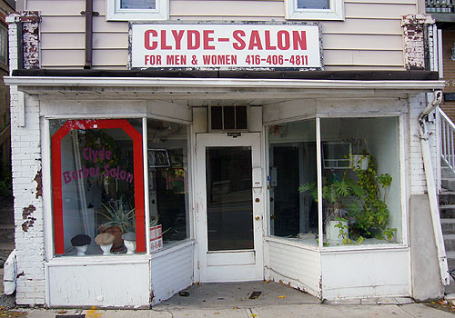 Dilapidated storefront has sign reading CLYDE SALON